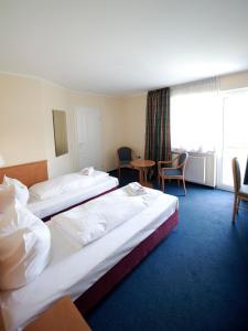 Dvoulůžkový pokoj s oddělenými postelemi