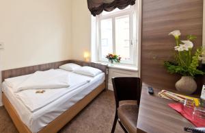 Enkeltværelse med fælles badeværelse
