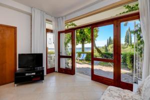 La Villa Fasano, Apartmánové hotely  Gardone Riviera - big - 96