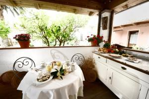 Il Giardino Degli Aranci, Отели типа «постель и завтрак»  Mores - big - 25