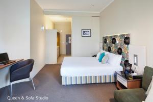 Studio s manželskou postelí velikosti Queen