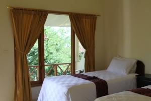 Waecicu Beach Inn, Penziony  Labuan Bajo - big - 8