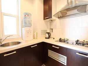 China Sunshine Apartment Guomao, Apartmány  Peking - big - 23