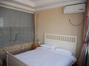 New Oriental Suites in Seasons Park, Апартаменты  Пекин - big - 8