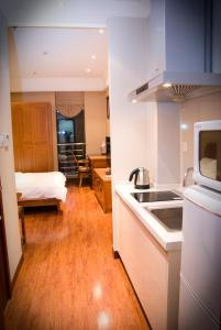 Chenlong Service Apartment - Yuanda building, Aparthotels  Shanghai - big - 10