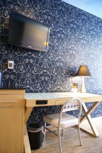 Familieværelse med byudsigt - 2 queensize-senge
