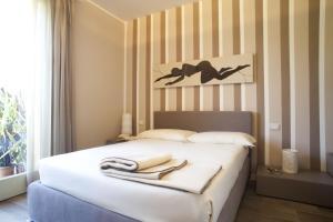 Residence Borgo Del Cigno, Apartmánové hotely  Spinone Al Lago - big - 13