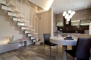 Residence Borgo Del Cigno, Apartmánové hotely  Spinone Al Lago - big - 14