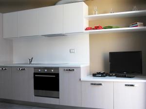 Residence Borgo Del Cigno, Apartmánové hotely  Spinone Al Lago - big - 20