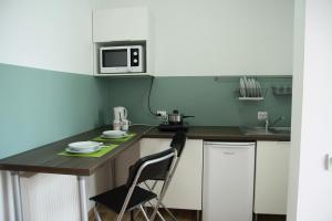 Studio ApartCity, Aparthotels  Braşov - big - 16