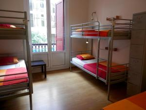 Bed in 5-Bed Dormitory Room with Shared Bathroom