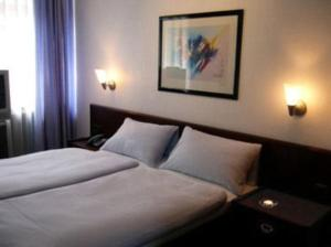 Dvoulůžkový pokoj s manželskou postelí nebo oddělenými postelemi