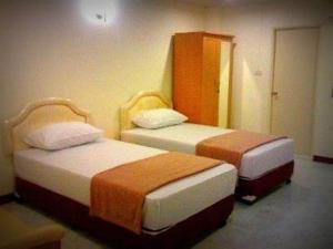 Klimatizovaný dvoulůžkový pokoj s oddělenými postelemi