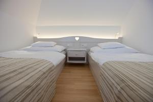 Tornácos Ház - Hegykő, Hotely  Hegykő - big - 10