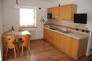Residence Ciasa Alpe, Apartmanok  Vigo di Fassa - big - 14