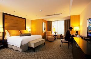 Pokój typu Deluxe z 1 łóżkiem typu king-size lub 2 łóżkami pojedynczymi