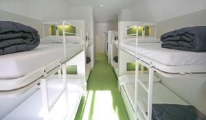 Bed in 12-Bed Dormitory Room with Bathroom