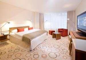 Dvoulůžkový pokoj typu Executive s manželskou postelí nebo oddělenými postelemi