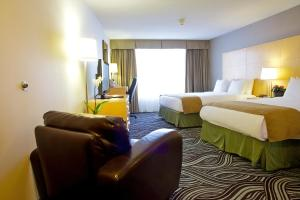 Pokoj typu Business Queen se 2 manželskými postelemi velikosti Queen