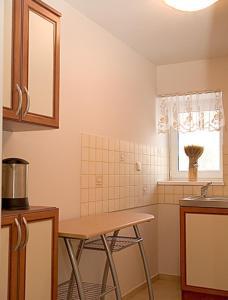 Domek w Kratkę, Affittacamere  Mielno - big - 36