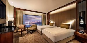 Pokój typu Executive z 2 łóżkami pojedynczymi, widokiem na park i dostępem do salonu Executive Lounge