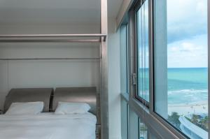 Deluxe One-Bedroom King Suite with Ocean and City View