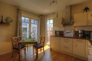 Ferienwohnungen Strandvilla Börgerende, Appartamenti  Börgerende-Rethwisch - big - 44