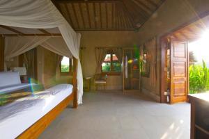 Three Monkeys Villas, Комплексы для отдыха с коттеджами/бунгало  Улувату - big - 9