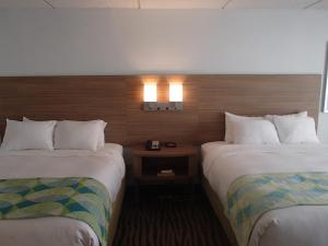 Premium Queen Room with Two Queen Beds with Ocean View - Non-Smoking