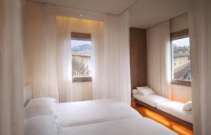 Pokój Dwuosobowy typu Deluxe z widokiem na rzekę Arno