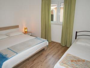 Apartments Eva i Toma, Ferienwohnungen  Povljana - big - 22