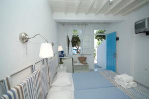 Asimina, Guest houses  Tourlos - big - 18
