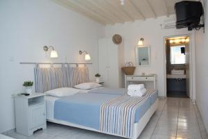 Asimina, Guest houses  Tourlos - big - 38