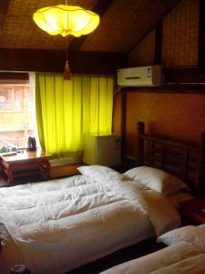 Lijiang Yu Shu Tang Inn, Vendégházak  Licsiang - big - 5