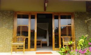 Three Monkeys Villas, Комплексы для отдыха с коттеджами/бунгало  Улувату - big - 13