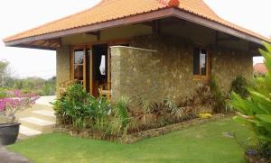 Three Monkeys Villas, Комплексы для отдыха с коттеджами/бунгало  Улувату - big - 14