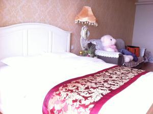 Dalian Yinghao Zuoan Classic Apartment, Apartmanok  Csincsou - big - 28