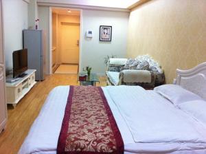 Dalian Yinghao Zuoan Classic Apartment, Apartmanok  Csincsou - big - 19