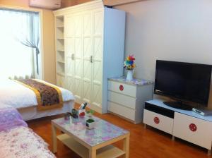 Dalian Yinghao Zuoan Classic Apartment, Apartmanok  Csincsou - big - 17