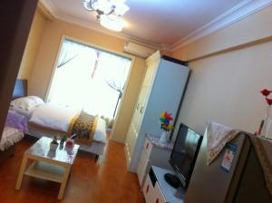 Dalian Yinghao Zuoan Classic Apartment, Apartmanok  Csincsou - big - 4