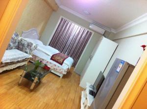 Dalian Yinghao Zuoan Classic Apartment, Apartmanok  Csincsou - big - 26