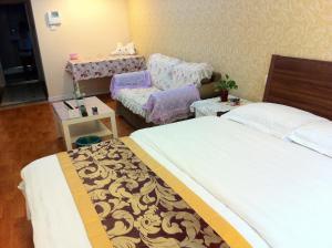 Dalian Yinghao Zuoan Classic Apartment, Apartmanok  Csincsou - big - 15