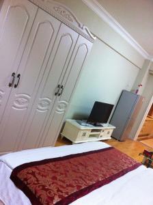 Dalian Yinghao Zuoan Classic Apartment, Apartmanok  Csincsou - big - 14