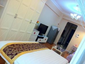 Dalian Yinghao Zuoan Classic Apartment, Apartmanok  Csincsou - big - 11