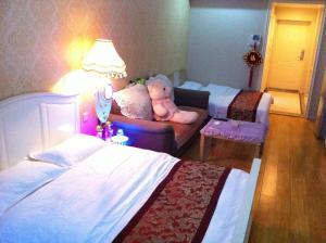 Dalian Yinghao Zuoan Classic Apartment, Apartmanok  Csincsou - big - 9