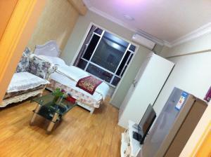 Dalian Yinghao Zuoan Classic Apartment, Apartmanok  Csincsou - big - 18