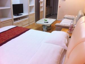 Dalian Yinghao Zuoan Classic Apartment, Apartmanok  Csincsou - big - 21