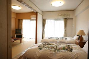 Garland Court Usami Private Hot Spring Condominium Hotel, Apartmanhotelek  Ito - big - 14