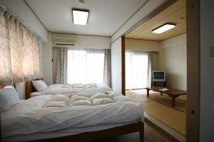 Garland Court Usami Private Hot Spring Condominium Hotel, Residence  Ito - big - 8