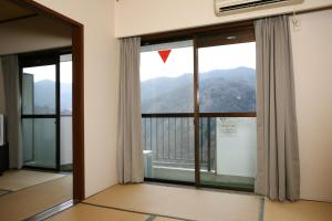 Garland Court Usami Private Hot Spring Condominium Hotel, Residence  Ito - big - 4